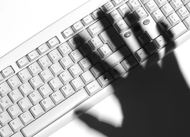 Shadow of a hand over a keyboard
