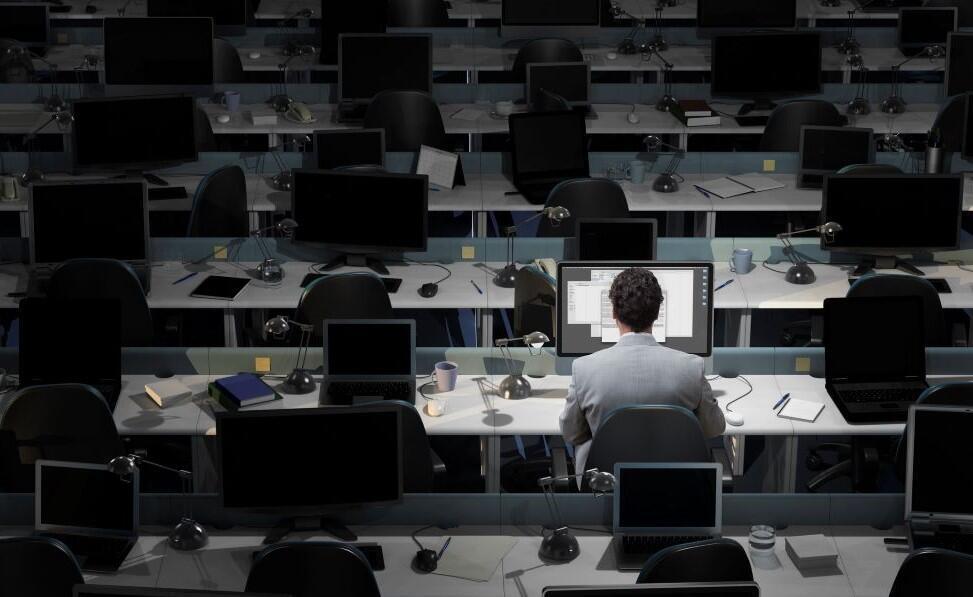 man-working-deserted-office.jpg