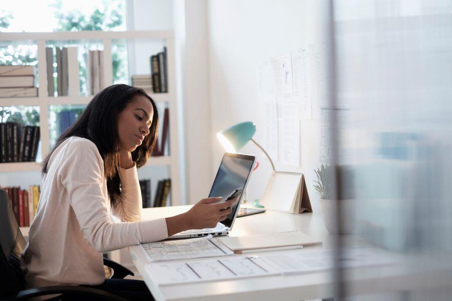 office-woman-looking-at-phone-stressed-remote-work.jpg